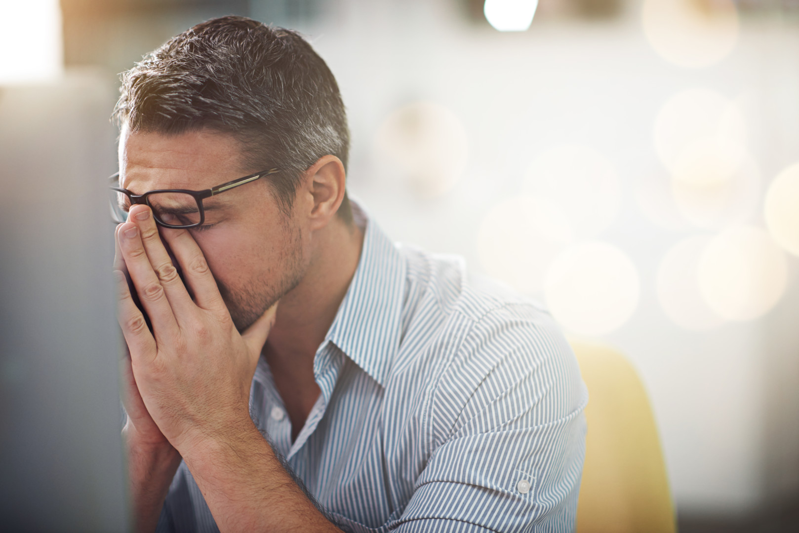 Image of a man rubbing his eyes in need of headache treatment