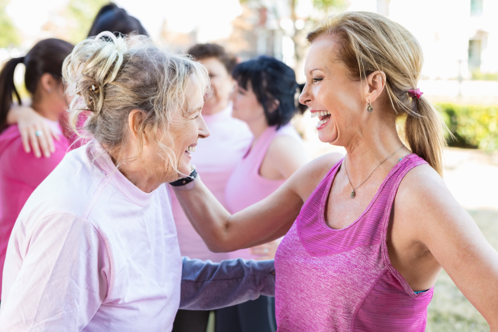 Two women smiling at each other feeling better after lymphedema treatment